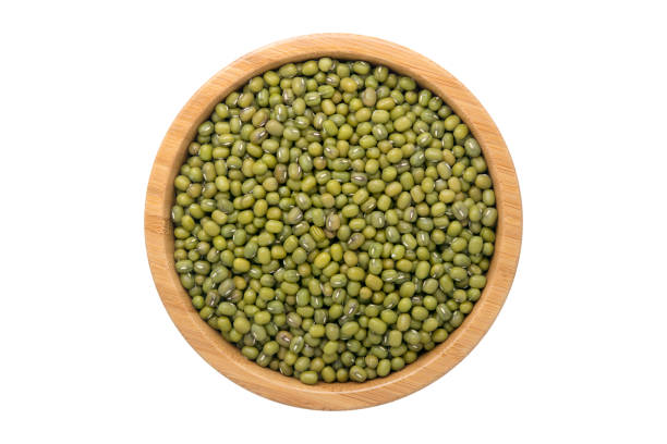 Top view of mung bean in wooden bowl isolated stock photo