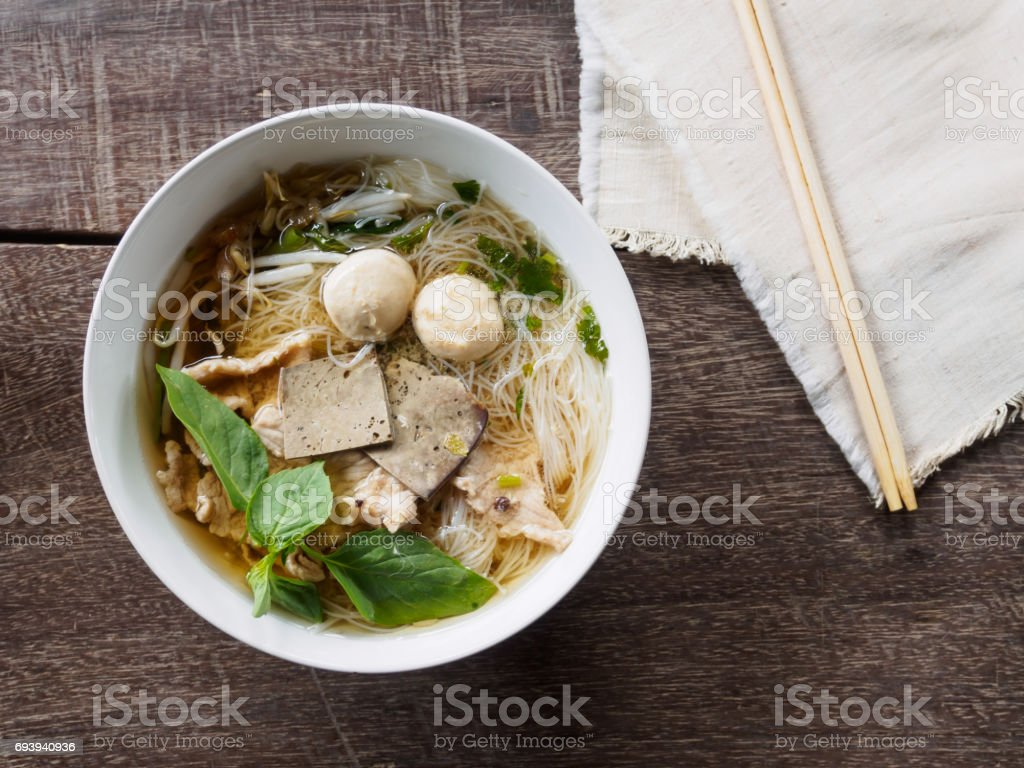 Top view of noodle with  chopsticks on wooden background stock photo