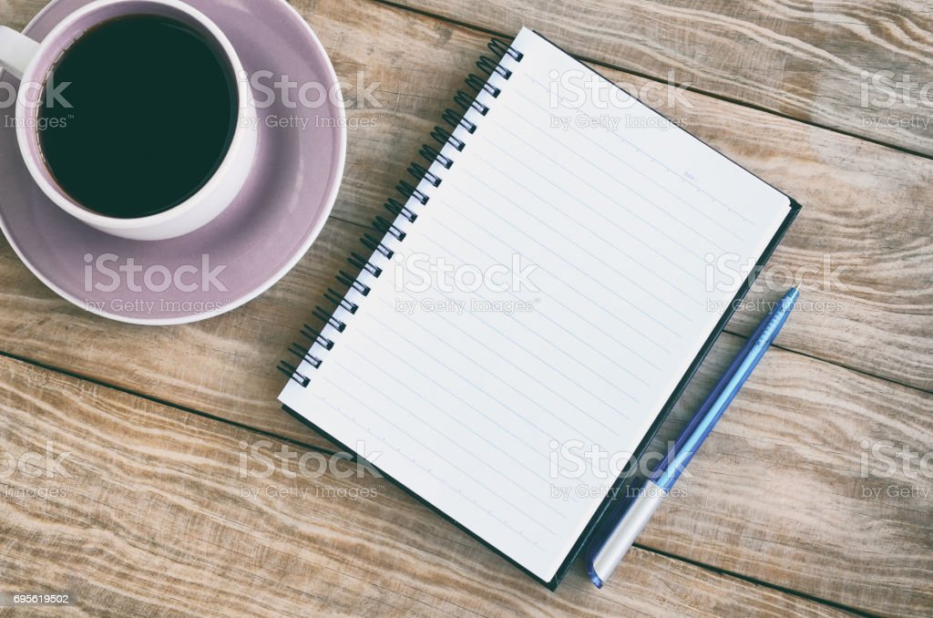 Top view of note pad, coffee and pen stock photo