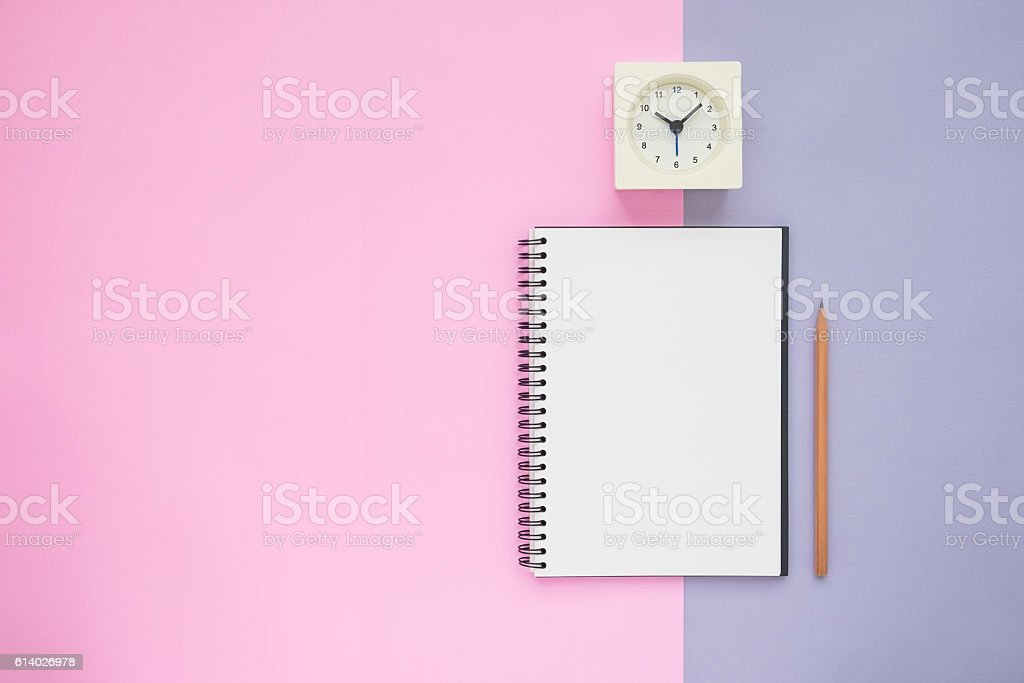 Top view of notebook pencil clock stock photo
