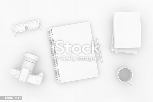 949860388istockphoto Top view of notebook with camera and books on white background 1138979617