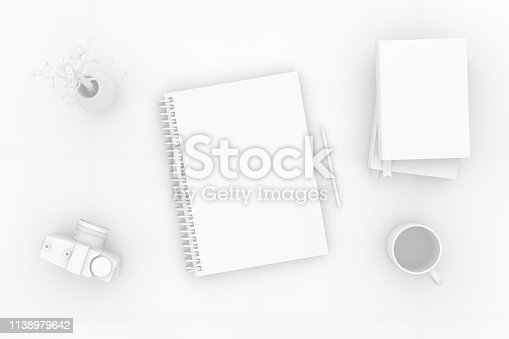 949860388istockphoto Top view of notebook with camera and books on white background 1138979642