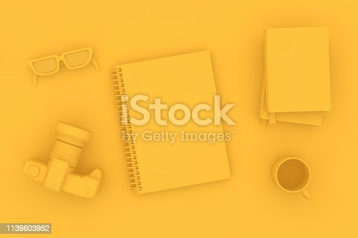 949860388istockphoto Top view of notebook with camera and books on yellow background 1139603952