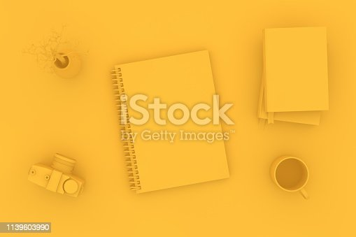 949860388istockphoto Top view of notebook with camera and books on yellow background 1139603990