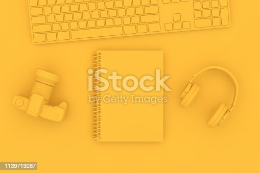 949860388istockphoto Top view of notebook with headphones and keyboard on yellow background 1139719267