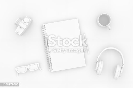 949860388istockphoto Top view of notebook with headphones and sunglasses on white background 1138979663
