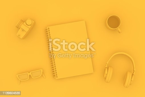 949860388istockphoto Top view of notebook with headphones and sunglasses on yellow background 1139604535