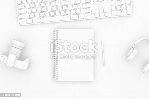 949860388istockphoto Top view of notebook with pencil and keyboard on white background 1138979384