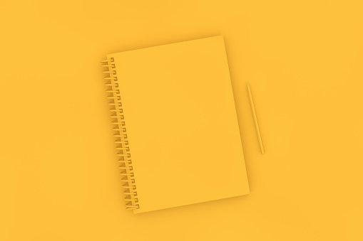 istock Top view of notebook with pencil on yellow background 1139603913