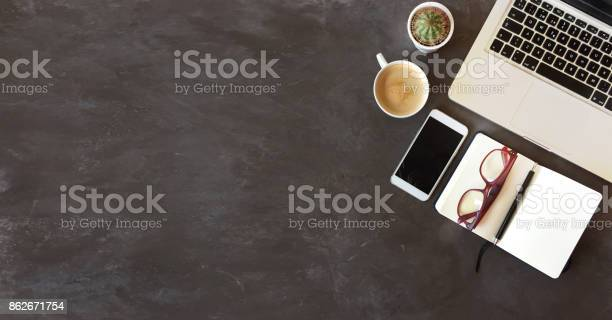 Top view of office desk on dark textured background picture id862671754?b=1&k=6&m=862671754&s=612x612&h=x8 seoknm35skwjezzge8tsvyktbbvgcihwak s0oaw=