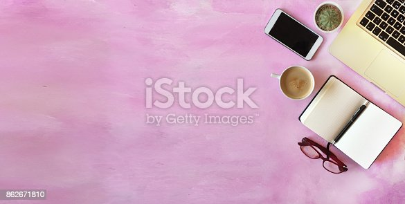 862672018 istock photo Top view of office desk on textured pink background 862671810