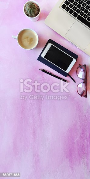 862672018 istock photo Top view of office desk on textured pink background 862671888