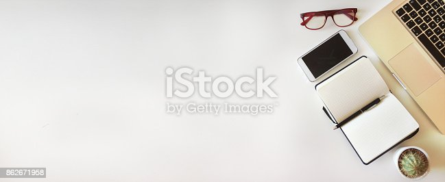 862672018 istock photo Top view of office desk on white background 862671958