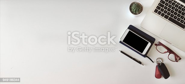 istock Top view of office desk on white background 949186344