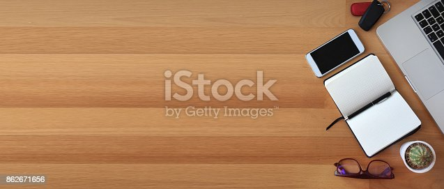 862672018 istock photo Top view of office desk on wooden background 862671656