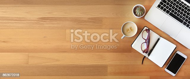 istock Top view of office desk on wooden background 862672018