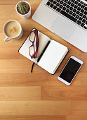 istock Top view of office desk on wooden background 862672022