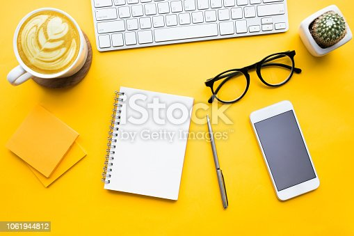 istock Top view of office desk table with modern accessories,supplies on color background. 1061944812