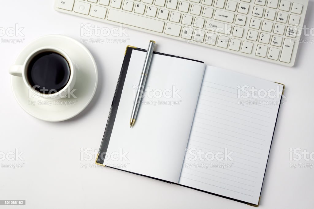 Minimalist concept - Top view of office desk with pen, coffee,...