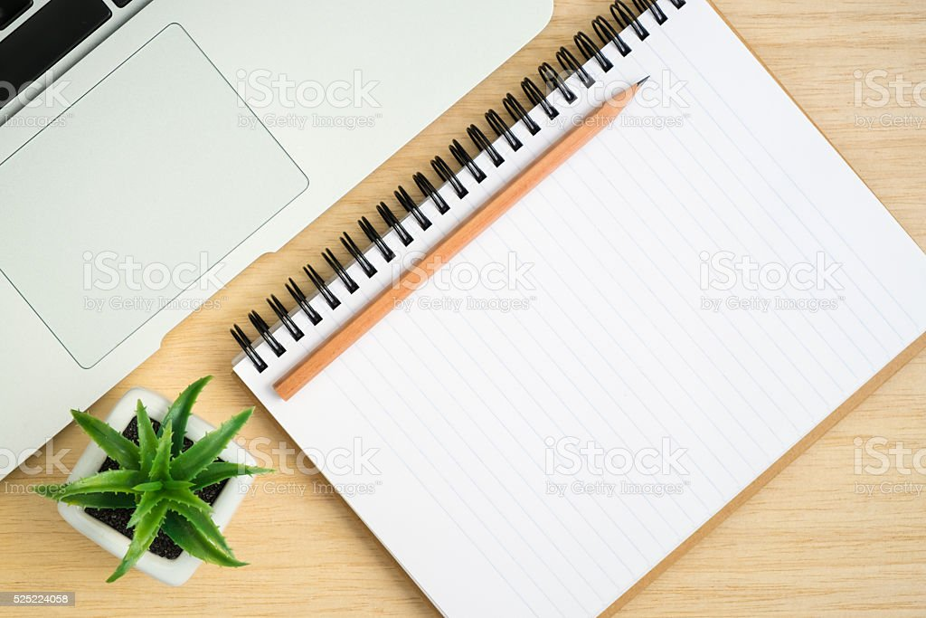 Top view of office desk with spiral notebook stock photo