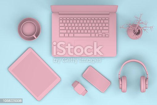 istock Top view of office desktop with Smart Phone, Digital Tablet and Laptop, Technology Concept. 1058225338