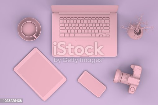 istock Top view of office desktop with Smart Phone, Digital Tablet and Laptop, Technology Concept. 1058225408