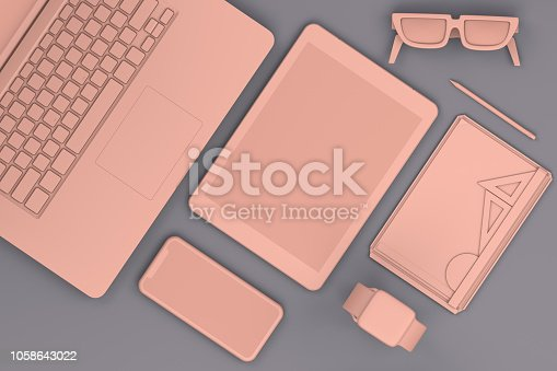 949860388istockphoto Top view of office desktop with Smart Phone, Digital Tablet and Laptop, Technology Concept. 1058643022