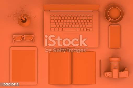istock Top view of office desktop with Smart Phone, Digital Tablet, Magazine and Laptop, Technology Concept. 1058010112