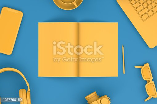 istock Top view of office desktop with Smart Phone,Magazine and Laptop, Technology Concept. 1057790150