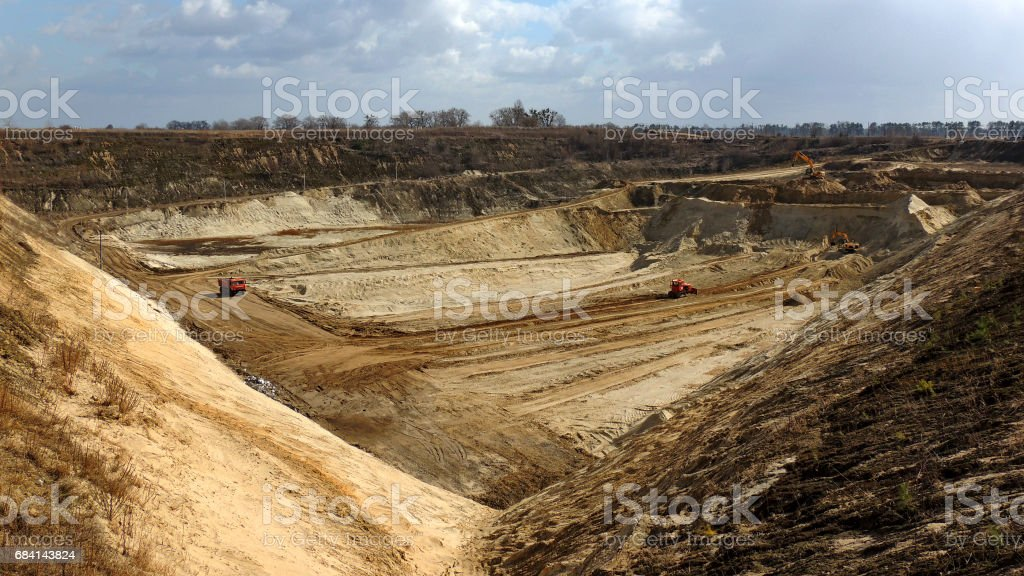 Top view of open air clay pit with mining excavators under blue sky foto stock royalty-free