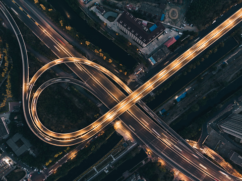 Drone View of Road Intersection and City Traffic at Night