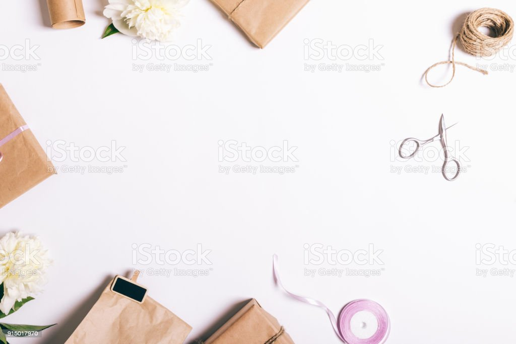 Top view of packing gifts for a holiday on a white table