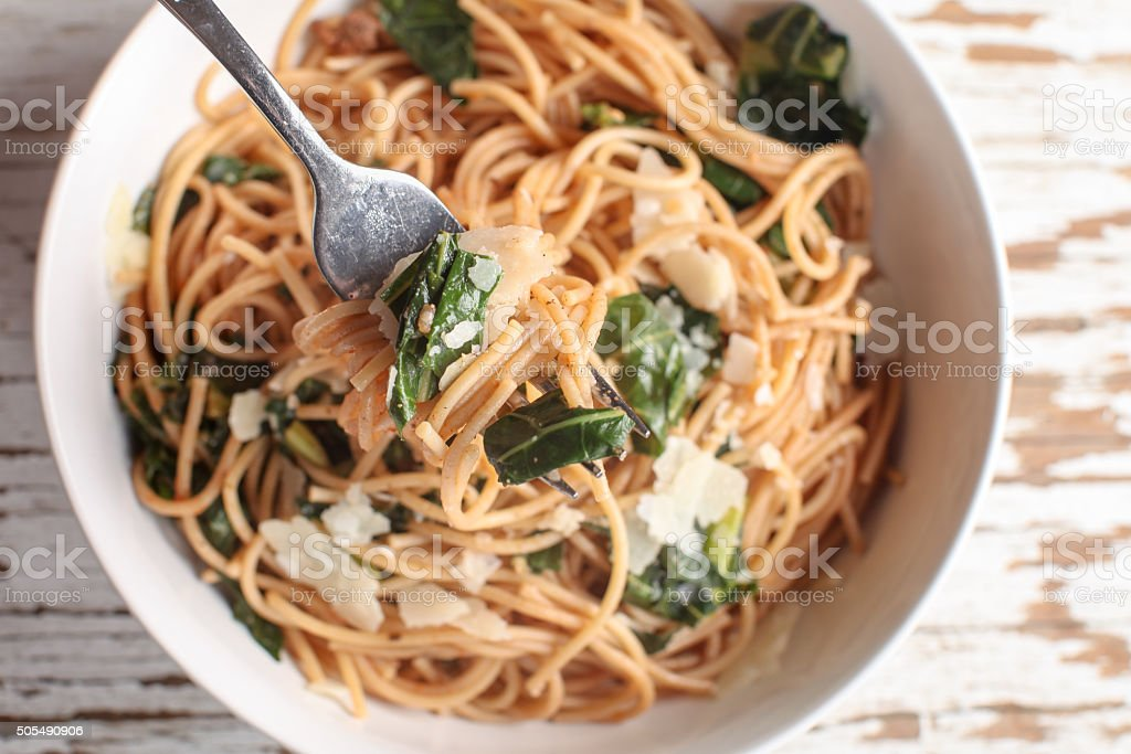 Top view of pasta dish with fork stock photo
