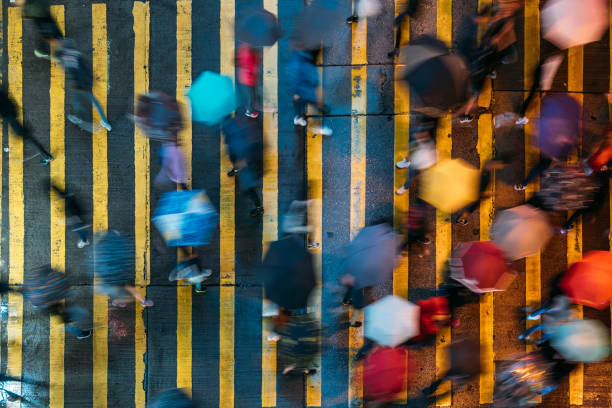 Top view of people crossing a very busy crossroads in Mong Kok district Hong Kong in China