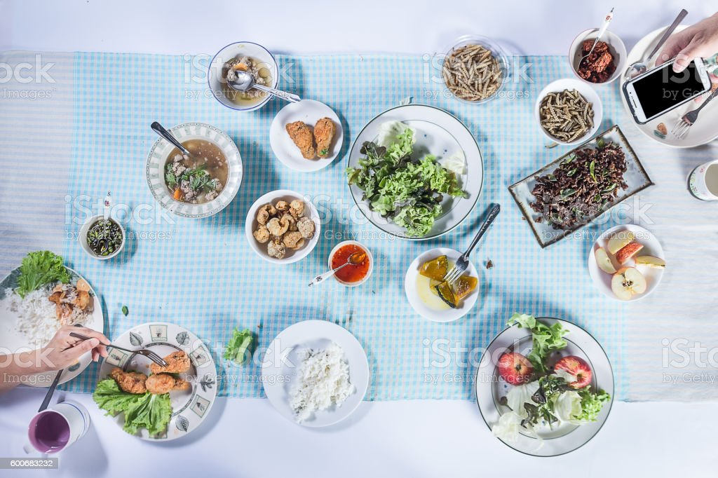 Top view of people eating food together. stock photo