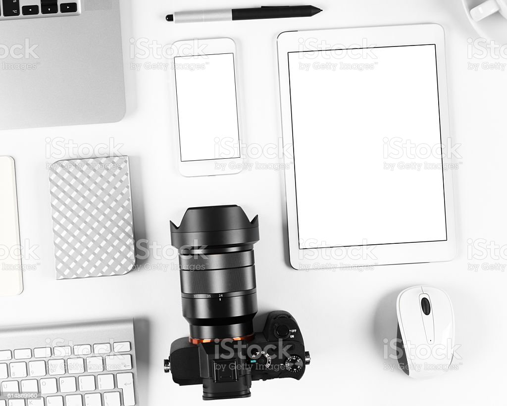 Top view of photographer workplace: Keyboard, tablet, camera and smartphone stock photo