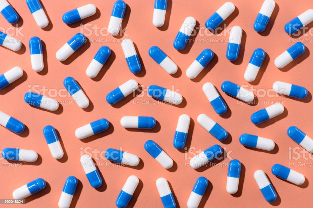 top view of pills on orange tabletop royalty-free stock photo