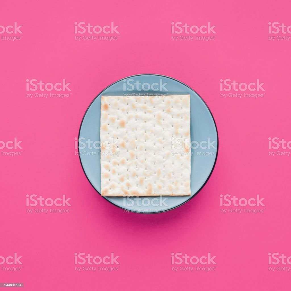 top view of plate with matza isolated on pink, Passover Tale concept stock photo