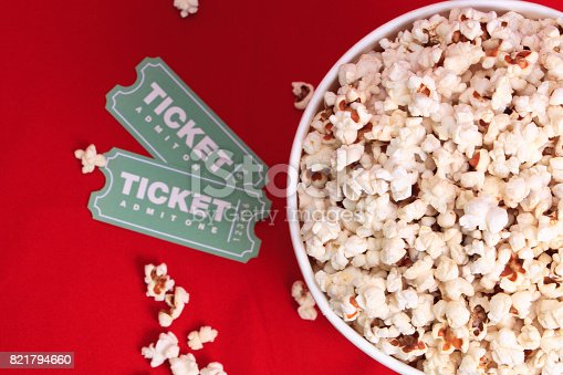 istock Top view of popcorn and movie tickets 821794660