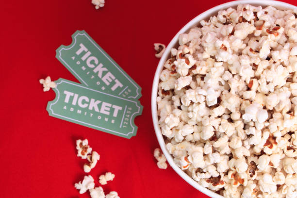 Top view of popcorn and movie tickets stock photo