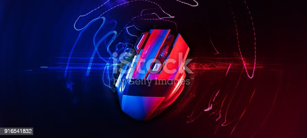 istock Top view of Professional wireless Game Mouse With hitech red and blue backgroud ; hight contrast 916541832