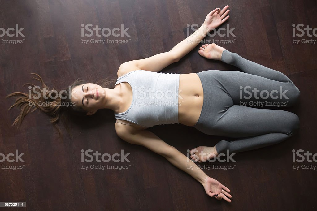 Top view of Reclining Hero yoga posture stock photo