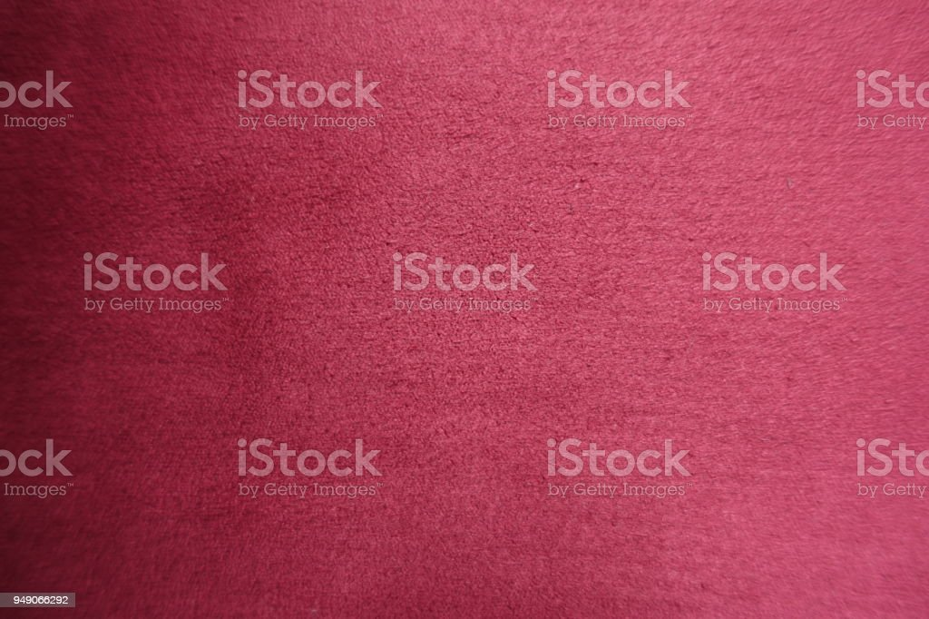 Top view of red artificial suede fabric stock photo