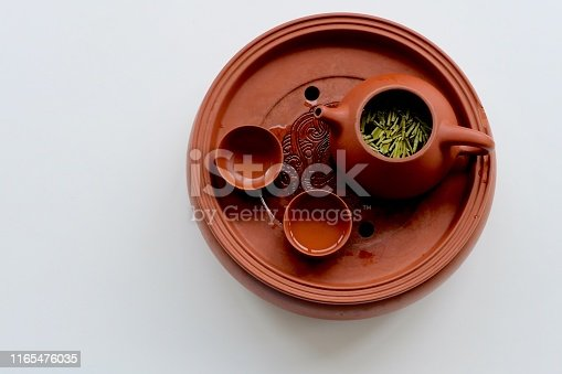 Fresh tea leaves floating on tea water. Traditional Chinese tea culture concept