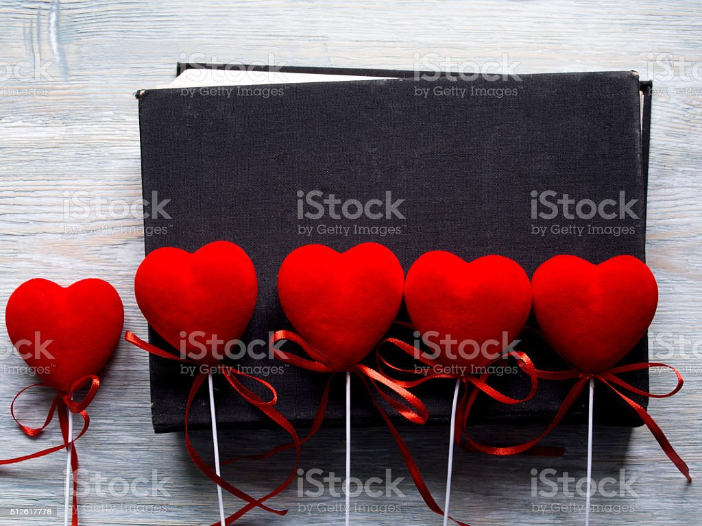 Top view of red hearts and old black book stock photo