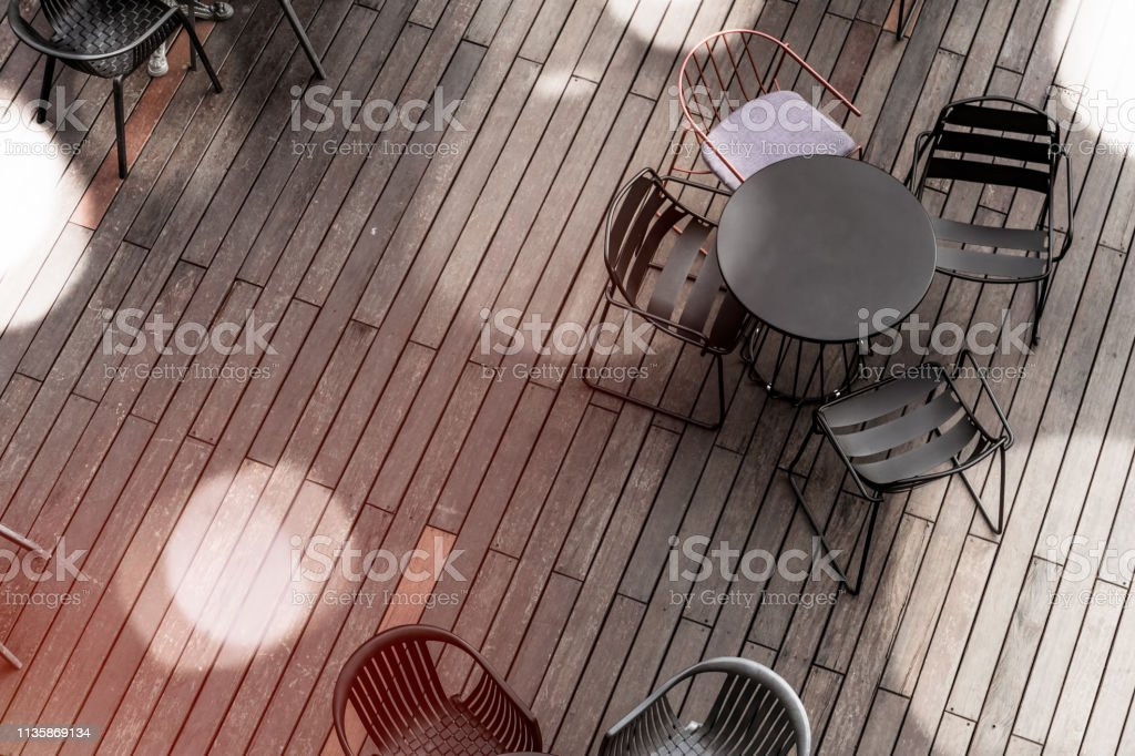 Top view of restaurant table with chairs with blank space.