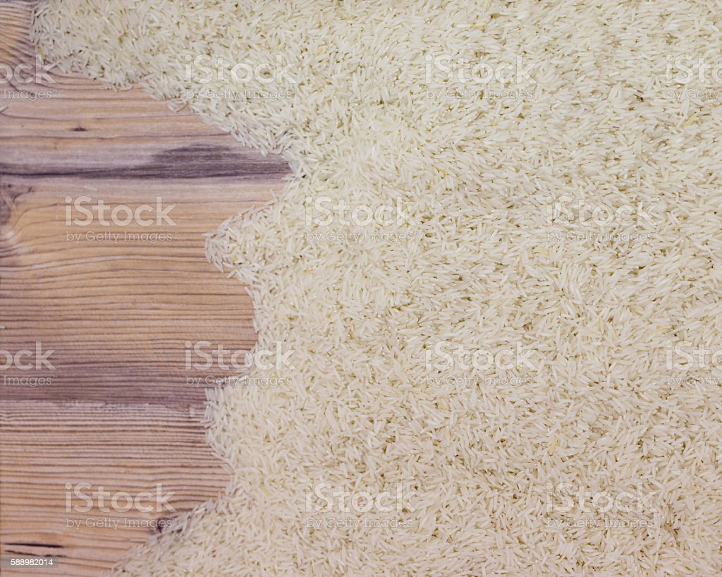 Top view of rice on wooden board stock photo