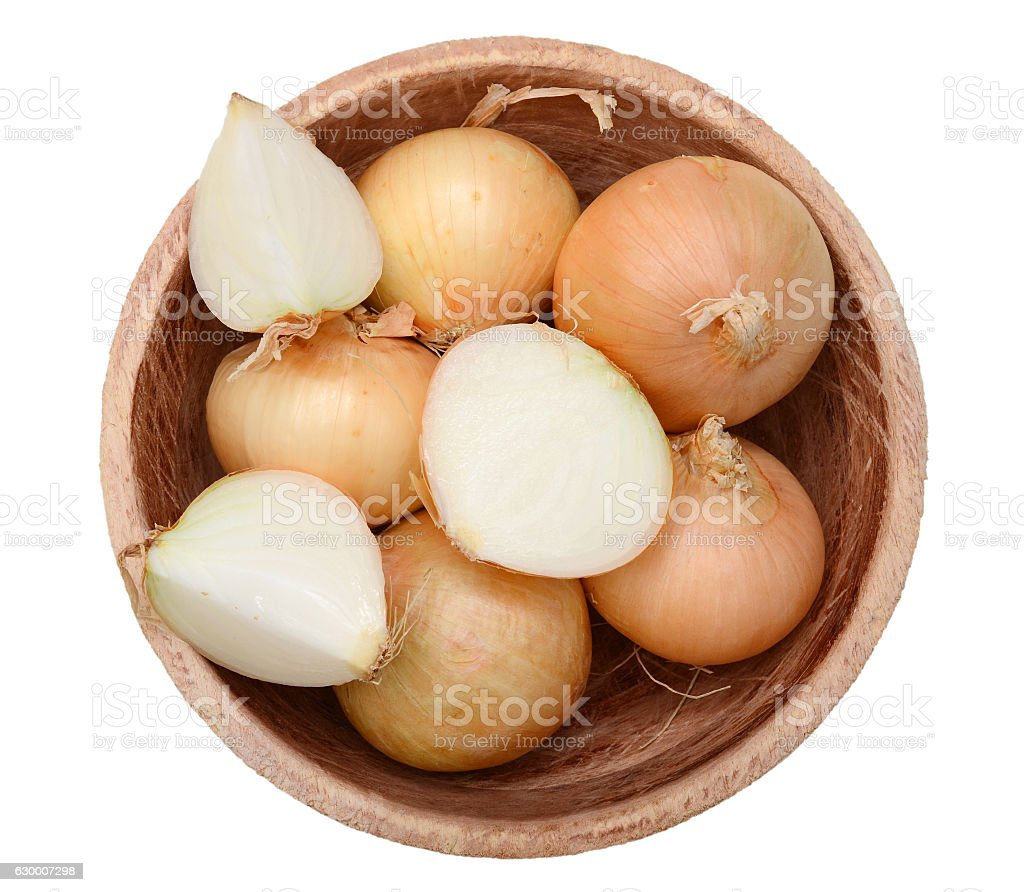 top view of ripe onions on wooden bowl isolated stock photo