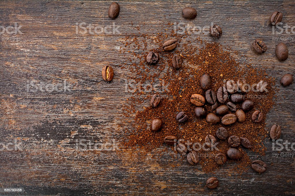 Top view of roasted coffee beans and ground coffee stock photo