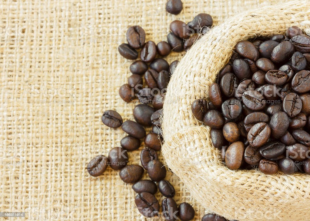 Top view of roasted coffee beans in jute bag royalty-free stock photo